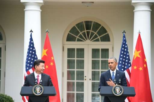US President Obama and Chinese President Xi Jinping hold a joint-press conference in the Rose Garden of the White House on Septe