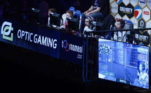 """US """"Optic gaming"""" team members compete during the Call of Duty Advanced Warfare Electronic Sports World Cup final, on"""