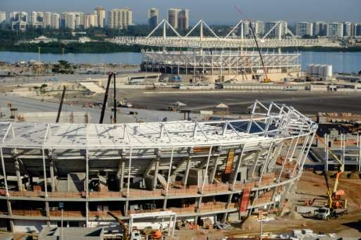 View of the Tennis Center (front) and the Aquatic Stadium for swimming and water polo for the Rio 2016 Olympic Games under const