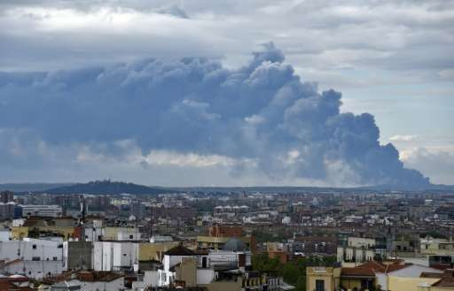 A huge smoke column caused by a fire in a tyre dump near the town of Sesena pictured from the Almudena cathedral in Madrid on Ma