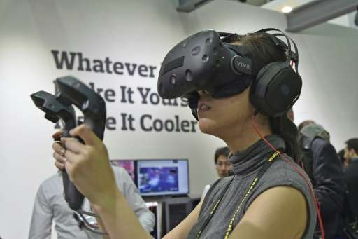 A visitor tests out the HTC Vive virtual reality (VR) headset during the annual Computex computer exhibition in Taipei on May 31