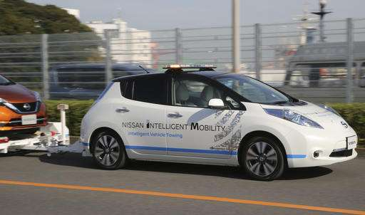 Cars without drivers scoot around Nissan plant, towing cars