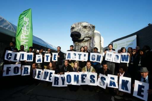 Greenpeace activists protest at the COP21 United Nations climate change conference in Le Bourget, outside Paris, on December 9,
