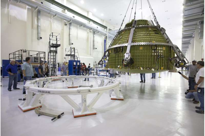 Orion Crew Module for Exploration Mission-1 Lifted to Test Stand