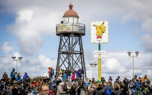 Pokemon Go players gather at the beach in Kijkduin on August 10, 2016
