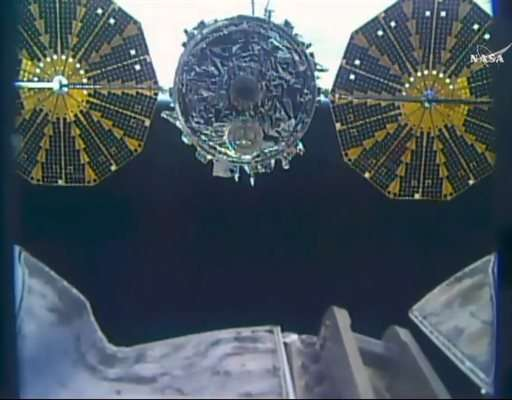 Space station astronauts give huge trash can the boot