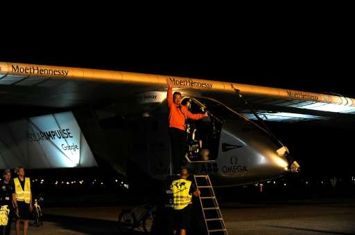 Swiss pilot Andre Borschberg waves before taking off in the Solar Impulse 2 aircraft at Sevilla aiport