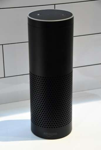 """The Amazon Echo links to a personal assistant """"Alexa"""" to answer questions and control connected devices"""