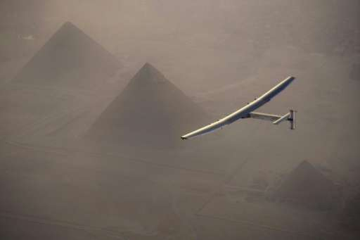 Solar Impulse 2 flys over the pyramids of Giza on July 13, 2016 prior to landing in Cairo, Egypt