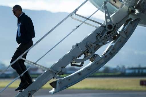 US President Barack Obama disembarks Air Force One