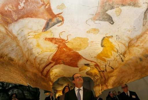 French President Francois Hollande visits Lascaux 4, a new replica of the prehistoric paintings of the Lascaux cave, in Montigna