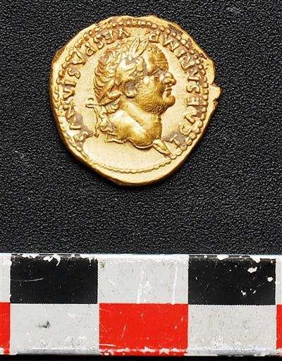 Skeletons, coins found in dig of ancient Pompeii shop