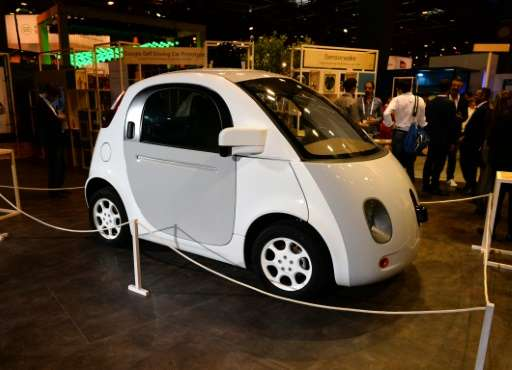 This picture taken on June 30, 2016 shows the Google's self driving car project on the Google stand at the Viva technology event