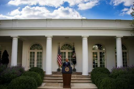 US President Barack Obama speaks about the Paris Climate Agreement from the Rose Garden of the White House in Washington, DC, Oc