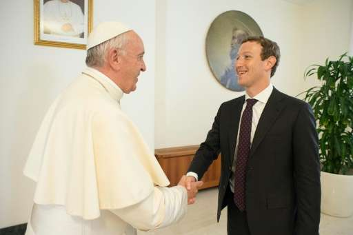 Facebook CEO Mark Zuckerberg met Pope Francis (L) earlier this year to discuss how to use communication technologies to alleviat