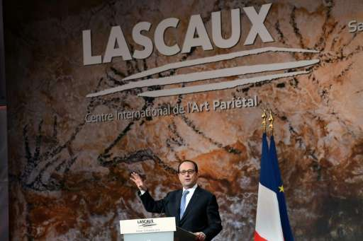 French President Francois Hollande gestures as he delivers a speech during the inauguration of the new museum Lascaux 4 on Decem