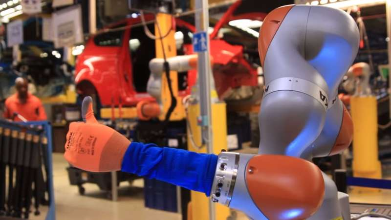 Car workers buddy up with robots as Ford applies industry 4.0 automation