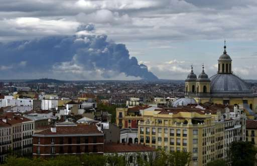 A huge smoke column caused by a fire at a tyre dump near the town of Sesena pictured from the Almudena cathedral in Madrid on Ma