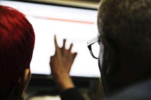 AP EXPLAINS: US ceding control of core Internet systems