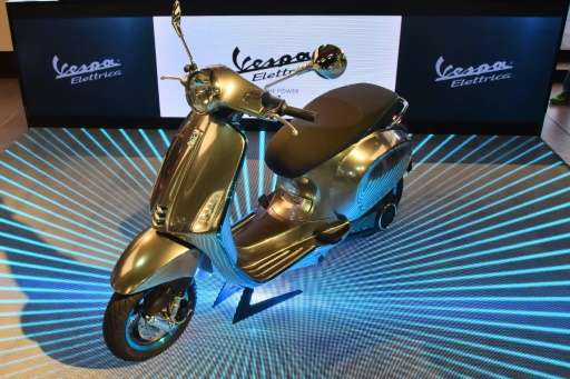"""A """"Vespa Elettrica"""" is presented during the EICMA, the International fair for cycles and motocycles, on November 10, 2"""