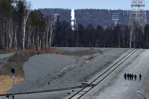 A Russian Soyuz 2.1a rocket carrying satellites stands on the launch pad at the new Vostochny cosmodrome outside the city of Ugl