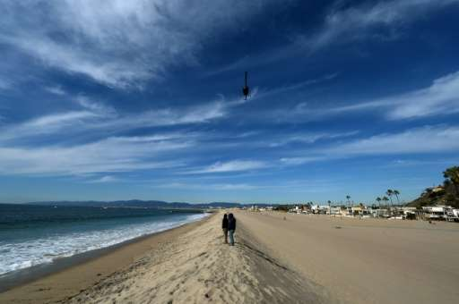 A sand berm created by city workers to protect houses from El Nino storms and high tides is seen at Playa Del Rey beach in Los A