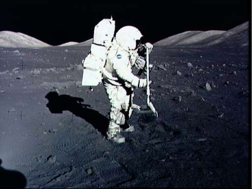 Astronaut Harrison Schmitt collects lunar rake samples at the Taurus-Littrow landing site on the moon during the Apollo 17 missi