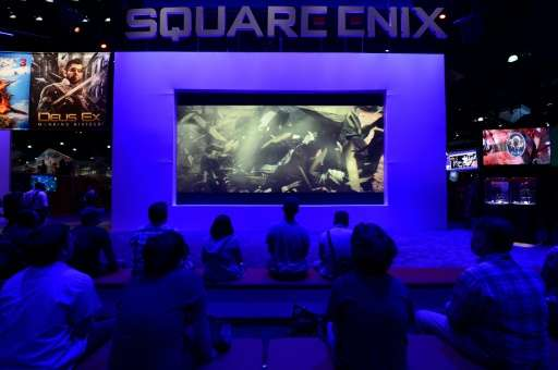 Attendees watch trailers for games from Japanese video game developer Square Enix at the E3 Electronic Entertainment Expo in Los