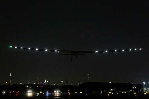 Bertrand Piccard of Switzerland pilots the Solar Impulse 2 aircraft as it takes off from John F. Kennedy International Airport i