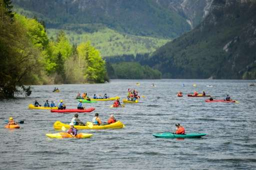 Canoeists and kayakers out on Lake Bohinj in Slovenia on April 16, 2016