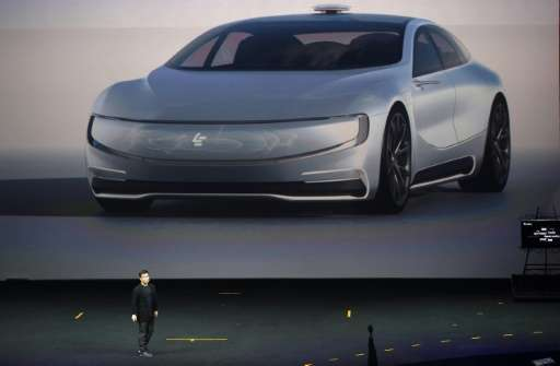 Chinese Internet giant LeECO Holdings Ltd unveils its internet electric battery driverless concept car 'LeSEE', during a launch