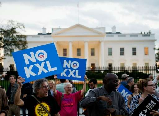 Demonstrators celebrating US President Barack Obama's blocking of the Keystone XL oil pipeline rally in front of the White House