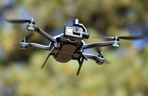 Drones launched from an autonomous vehicle could help guide it by mapping surrounding areas beyond what the car's sensors can de
