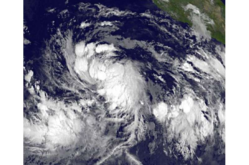 Early daylight satellite image shows depression intensify into Tropical Storm Celia