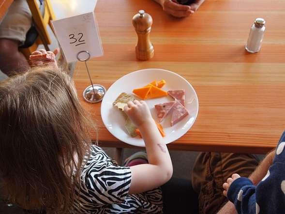 Encouraging children to order healthier foods in restaurants
