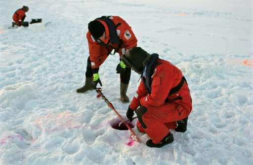 Engineers brave the mercury at minus 15 degrees Celsius (5 degrees Fahrenheit) to descend onto the ice, drilling holes to inject