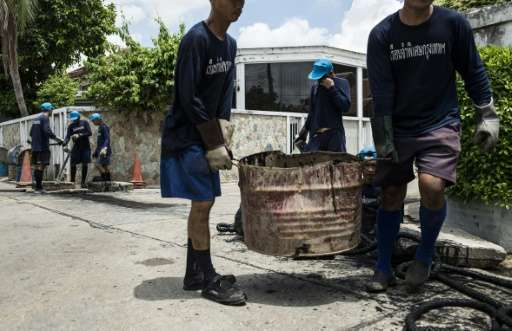 Every day city workers descend into Bangkok's sewers to try and clear the sludge, supported by convicts who earn time off their