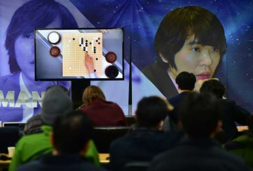 Fans watch a live broadcast of South Korean Lee Se-Dol's clash with the Google-developed supercomputer AlphaGo in Seoul on March