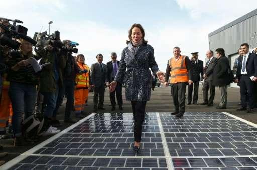 French Ecology Minister Segolene Royal walks on solar-power road panels in Marseille