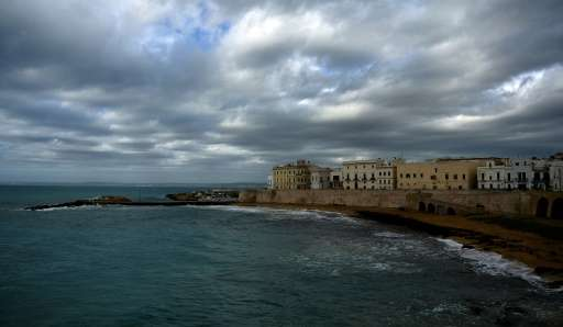 Gallipoli on the Salento peninsula on Italy's heel lies in a region where abundant olive groves are synonomous with the timeless