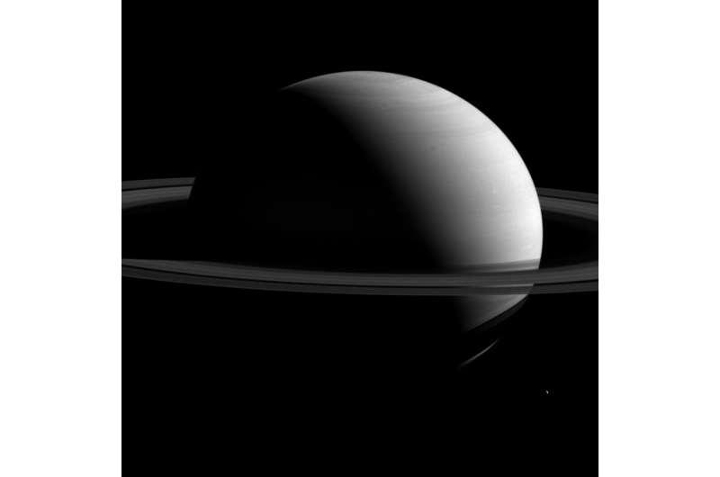 Image: Tethys dwarfed by Saturn