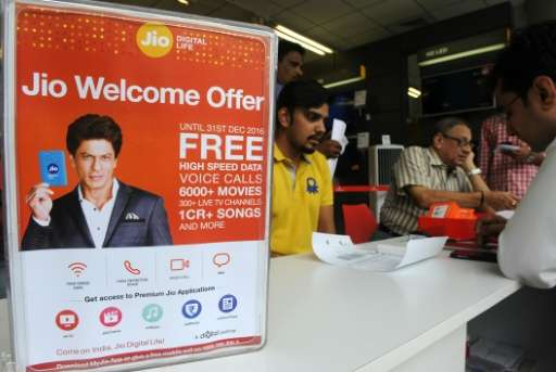 Indian customers wait to purchase Reliance Jio Infocomm 4G mobile service SIM cards at a store in Mumbai on September 6, 2016