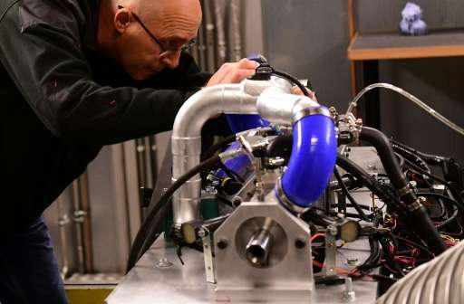 Industry analysts question whether a super-efficient engine invented by Shaul Yakobi (L), co-founder of Aquarius Engines, can su
