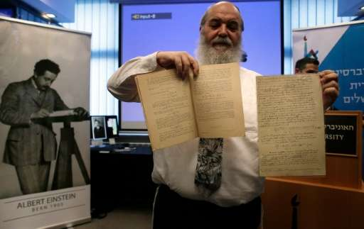 Israeli Doctor Roni Grosz, head of The Albert Einstein Archives at the Hebrew University of Jerusalem, shows the original docume