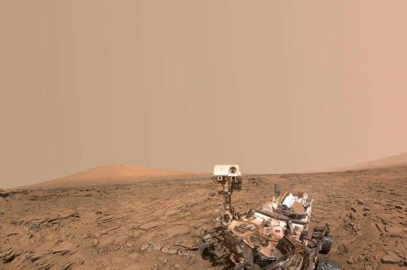 NASA Mars rover descends plateau, turns toward mountain