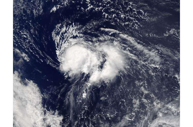 NASA sees Nicole dwarfed by Hurricane Matthew