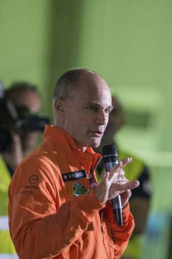 Pilot Bertrand Piccard talks to the media before his take-off in the Solar-powered Solar Impulse 2 aircraft, from the Cairo Inte
