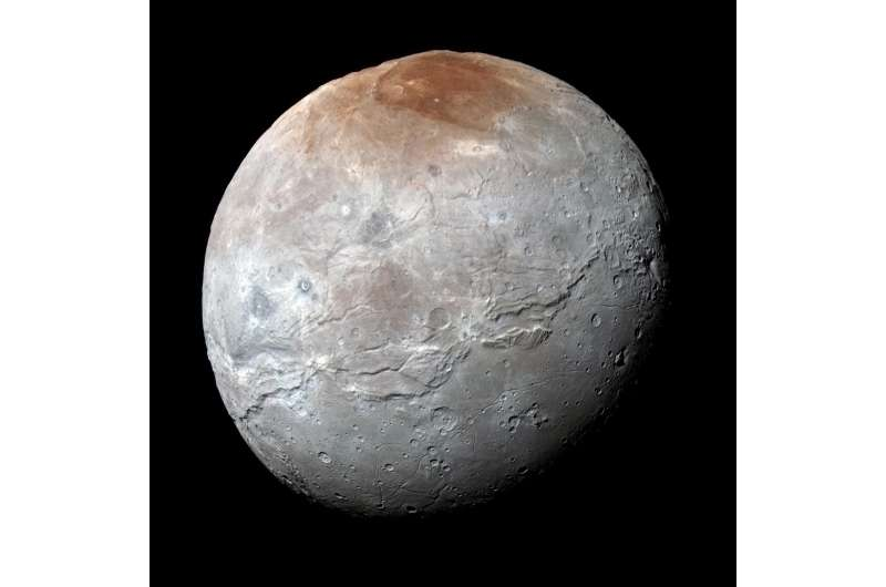 Pluto 'paints' its largest moon red