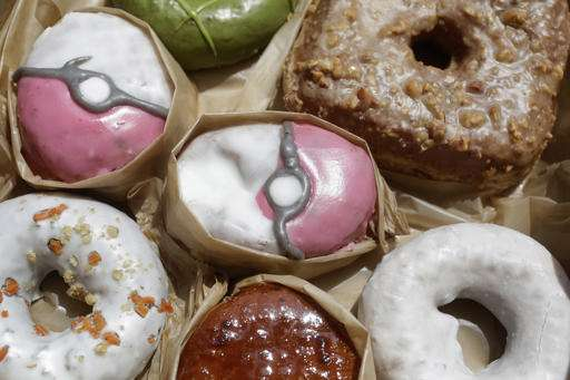 Pokemon doughnuts, exercise classes tap game's popularity.