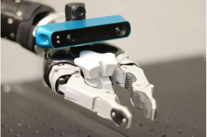 Robot's in-hand eye maps surroundings, determines hand's location